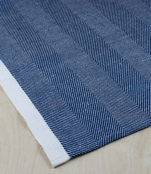 A 100% 'European Masters of Linen' linen, herringbone weave table runner, measuring 43cm x 150cm. A timeless classic, this Scandinavian blue and white..