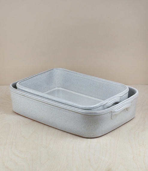 Mottled white glazed terracotta rectangular baking or serving dishes in a choice of two sizes. Hand shaped, glazed, and finished by the artisans of Ma..
