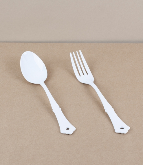 A choice of dining fork or spoon, both of white vitreous enamel over stainless steel. Enamel is made by the high temperature fusion of powdered glass ..