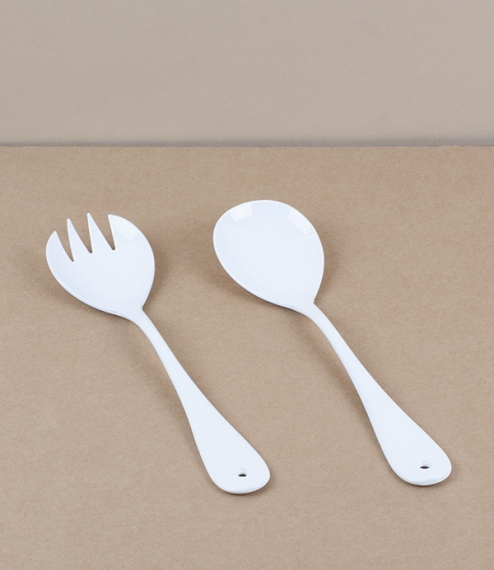 A set of salad serving spoons of white vitreous enamel over stainless steel. Enamel is made by the high temperature fusion of powdered glass slurry to..