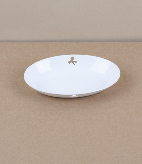 A simple oval soap dish of white vitreous enamel over stainless steel. Enamel is made by the high temperature fusion of powdered glass slurry to in th..