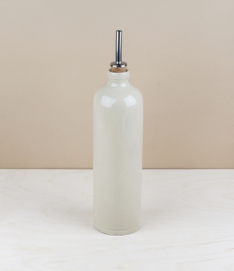 A 0.6 litre stoneware oil or vinegar drizzling bottle with a clear ash 'naturel' glaze. Hand made in the northern Loire valley by Poterie Digoin, foun...