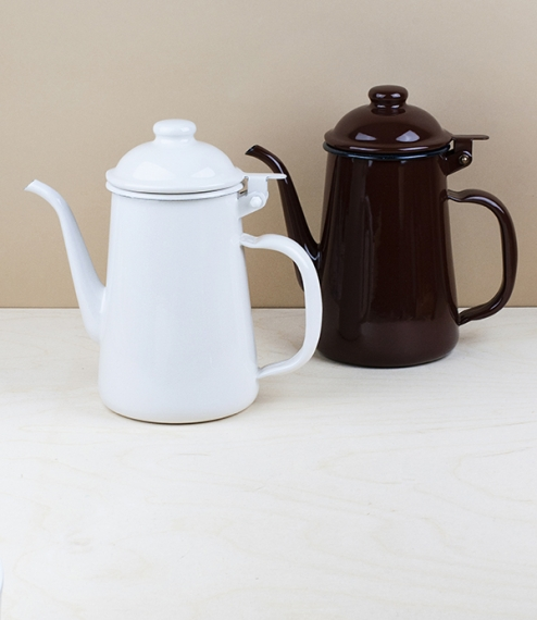 A choice of coffee pots of brown or white vitreous enamel over steel. Enamel is made by the high temperature fusion of powdered glass slurry to in thi..