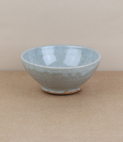 A hand thrown individual serving or breakfast bowl with a blue-grey nuka glaze. After training in Cardiff and Gothenburg, Sweden, Welbourne set up stu..