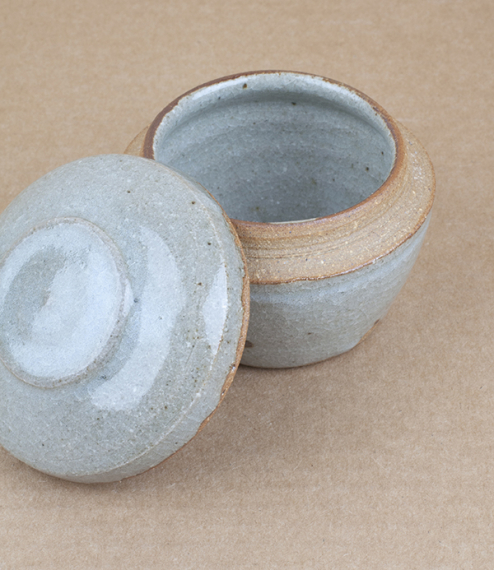 Small hand-thrown preserve, condiment, or trinket, jar with a blue-grey nuka glaze. After training in Cardiff and Gothenburg, Sweden, Welbourne set up..