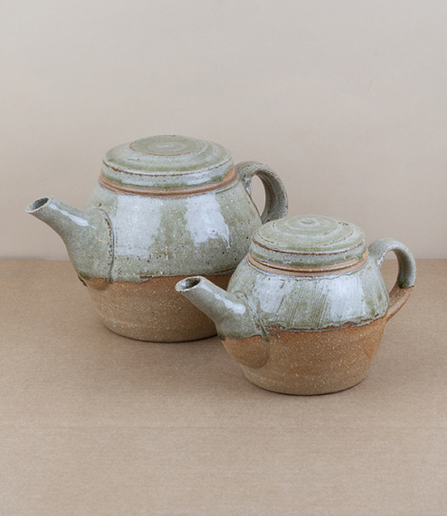 A choice of blue-grey nuka glazed teapots, a smaller of one to two cups capacity, or larger of maybe 3 to 4 cups. After training in Cardiff and Gothen..