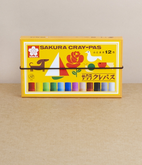 A box of 12 children's oil pastels from Sakura of Japan. Made from a mixture of pigment, oil, and wax. First created in 1925, these were initially ava...