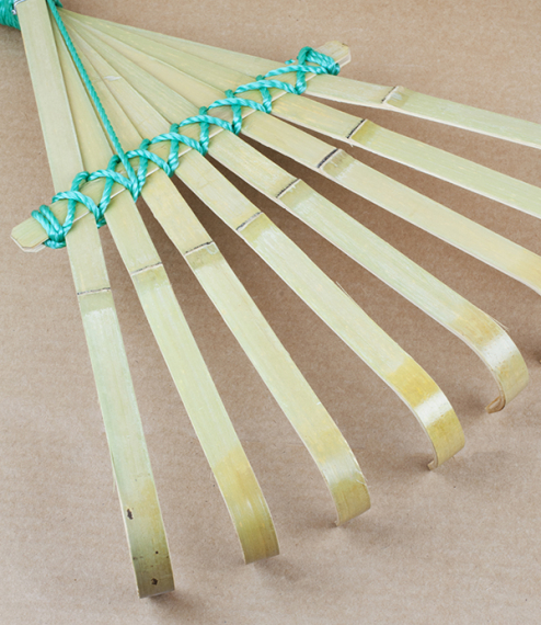 A split bamboo hand rake made with eight heat formed clawed tines cut, shaped, and tied in Japan. Ideal as a small rake for work in borders clearing a..