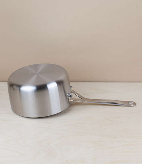 English tri-ply stainless steel saucepan