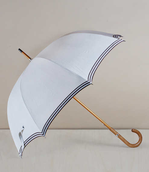An eight ribbed fit-up parasol-umbrella made with an SPF 50 rated linen canopy stretched over a steel frame, and with a maple shaft and handle. Fit-um..
