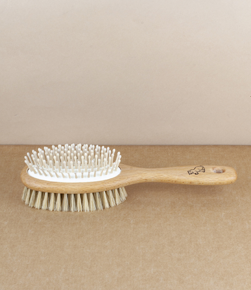 A beech wood brush for dogs, with one face consisting of hornbeam pins, for detangling, and the other side set with natural pig bristle, to help pull ..