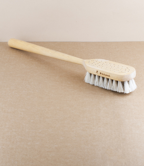 A long-handled brush of birch wood and horse hair used for massaging the body. The practice of dry massaging exfoliates and encourages renewal of the ..