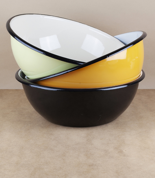 A choice of various coloured 28cm diameter black rimmed vitreous ceramic enamel serving, prep, or cooking bowls. Firing in a traditional kiln results ..