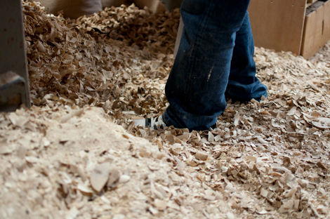 Wood shavings by a lathe in the Takahashi Kougei workshop.