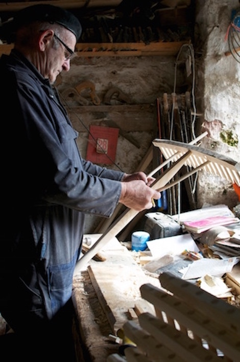 John Rudd at his bench fitting the bow to one of their larger rakes.