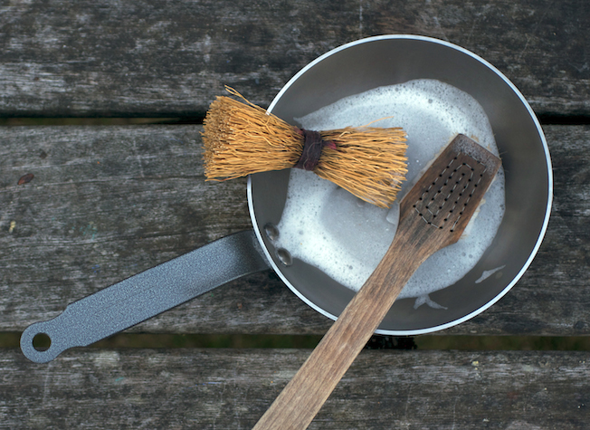 Washing a new Lyonnaise pan with a Swedish scrubbing whisk and Iris Hantverk dishbrush.