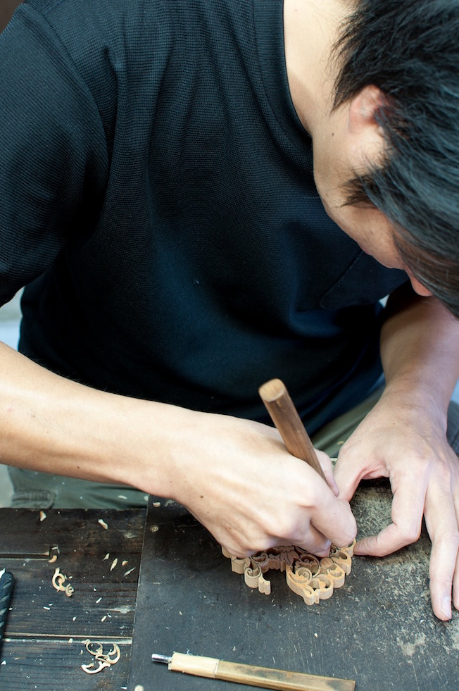 Takahiro Nishi of Nishi Sculpture Works carving cedar in his workshop at Kawanabe town, Kogoshima Prefecture.