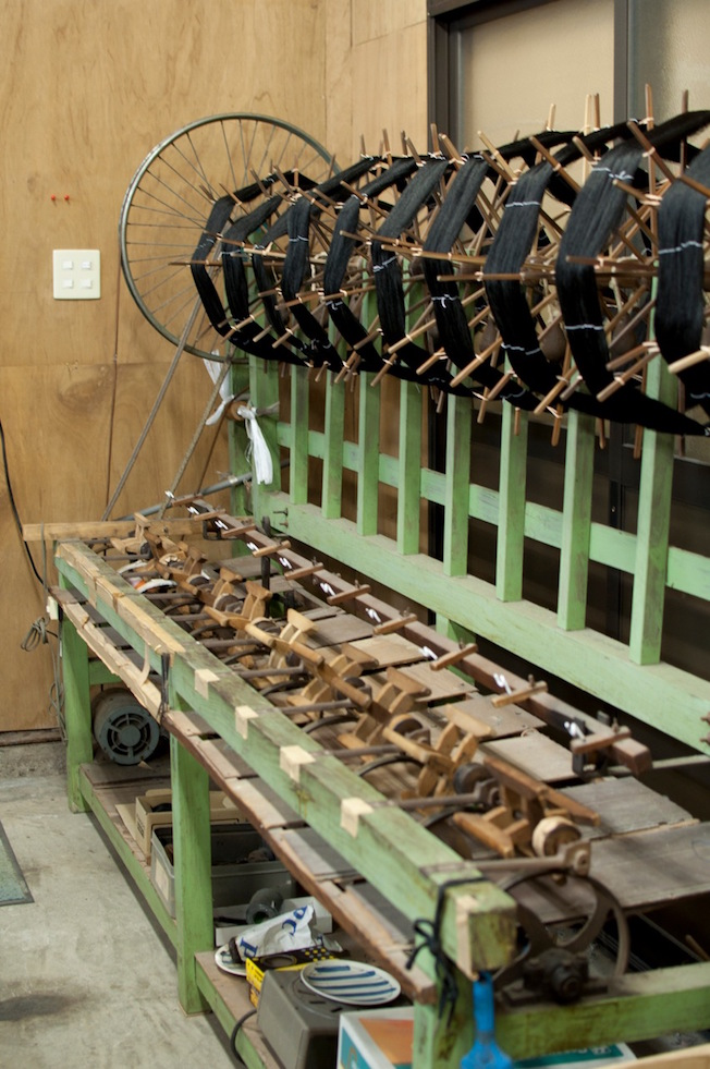 A large winding machine, using a nicely adapted bicycle wheel as part of the mechanism.