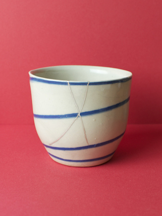Kintsugi demonstration at Objects of Use - the silver repaired Grange village beaker, exterior