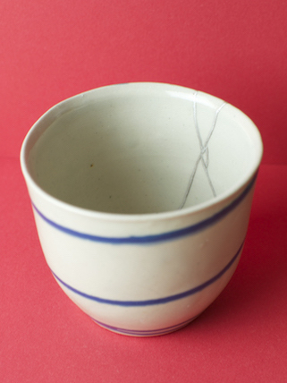 Kintsugi demonstration at Objects of Use - the silver repaired Grange village beaker, interior