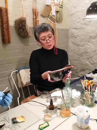 Kintsugi demonstration at Objects of Use - gluing the Leach pottery bowl
