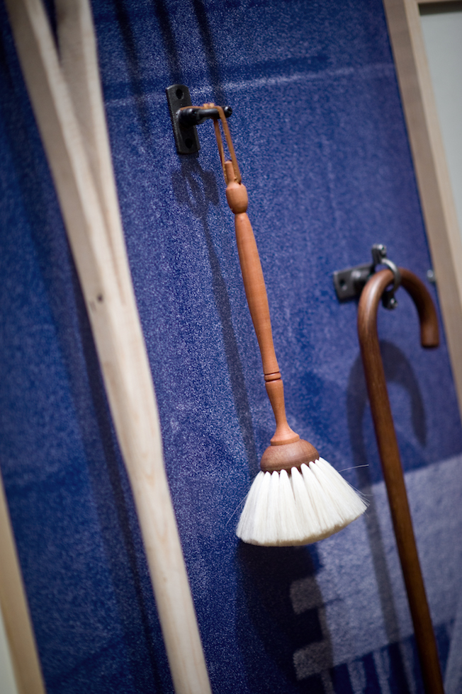 Part of a rake, a dusting brush, and a Japanese broom at the Laing.