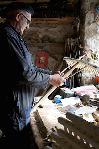 John Rudd at his bench fitting the bow to one of thier larger rakes.