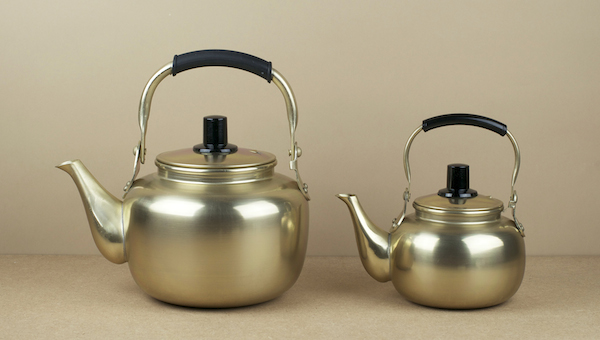 Gold anodised aluminium kettles from Deagu in South Korea. Traditionally these have been used for the serving of makgeolli, a sort of alcoholic milky ..