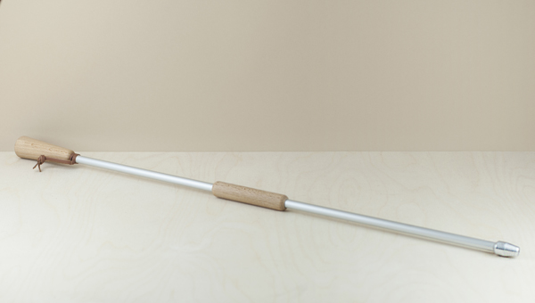 An aluminium blow pipe with an oiled beechwood mouthpiece and handle and a leather hanging strap. Originating in the mountainous Massif Central region..